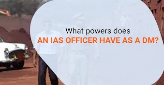 What powers does an IAS officer have as a District Magistrate?
