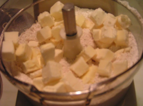 In your food processor, place the flour, brown sugar, and salt and process to...