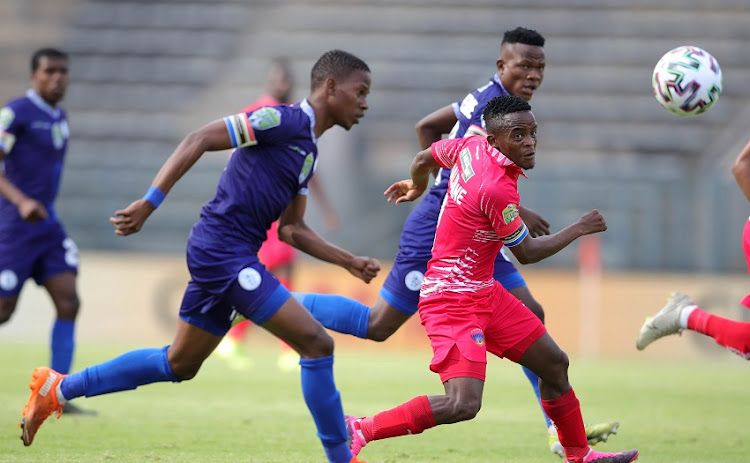 Peter Maloisane of Chippa United challenged by Boitumelo Pheko of Pretoria Callies during the Nedbank Cup semi final match between Pretoria Callies and Chippa United at Lucas Masterpieces Moripe Stadium on April 17, 2021 in Pretoria, South Africa.