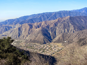 Photo: View northwest from Glendora Ridge Motorway toward Mountain Cove in the mouth of San Gabriel Canyon. The tan area behind it was burned by the Madre Fire on September 24, 2013, just 3 months earlier.