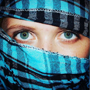 woman in hijab green eyes