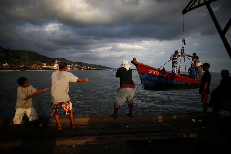 Fishermen arrive at the Fisherman's Wharf in La Libertad, El Salvador.