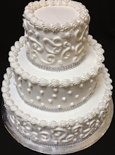 Photo: Wedding cake featuring two different designs: Town & Country Dot border (top & bottom) and single dots (middle). Traditional borders on tops w/silver diamond wrap around bottoms.