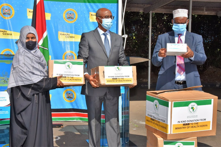 Health CAS Rashid and Marsabit Governor Mahamud Ali receive PPE's worth Sh2.5 million donated by IGAD on May12, 2020. They were handed over by IGAD Secretariat Coordinator Fatuma Adana.