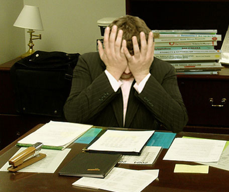 File:Frustrated man at a desk (cropped).jpg