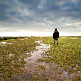 A Man Stares... by Nuno Martins - Landscapes Beaches ( ericeira, ribeira de ilhas, beach, man, sunset, boy, clouds )