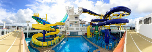 Norwegian-Escape-WaterSlide - Grab an inner tube and compete against a friend or family member when you tackle Aqua Racer, the newest tandem waterslide at sea.