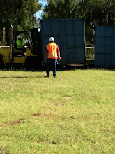 Photo: Using the forklift to set the bin on its foundation