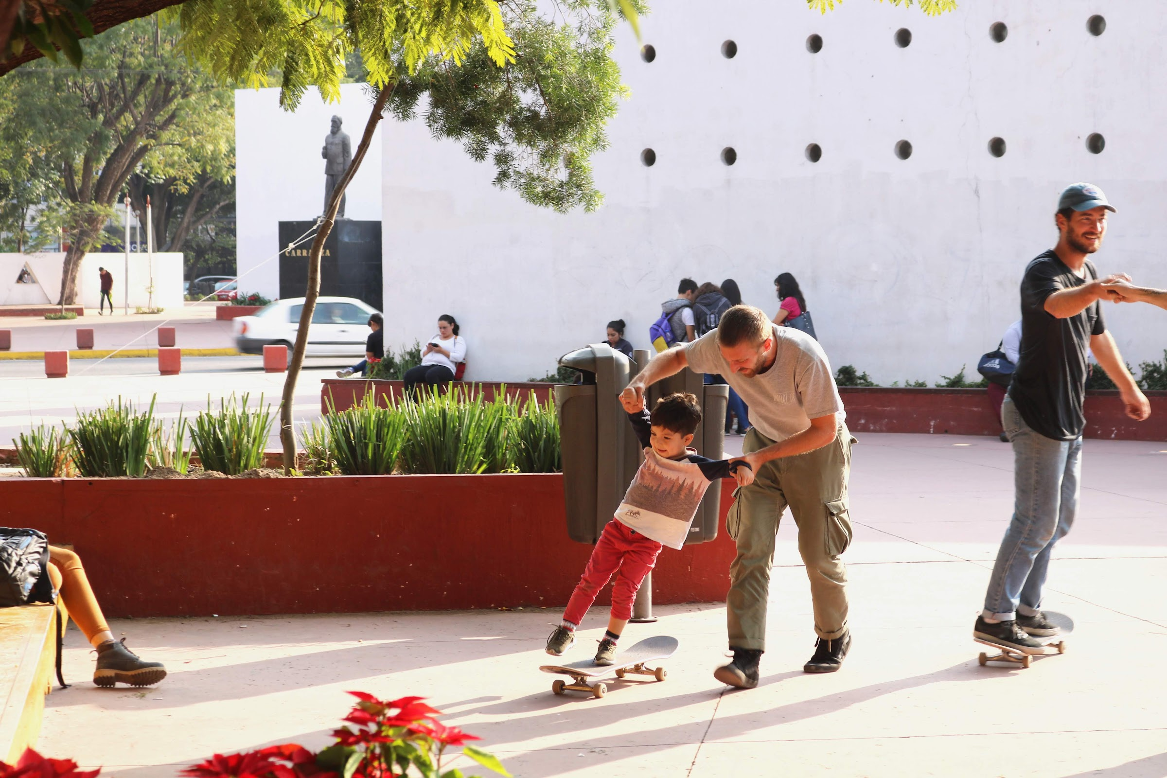 Skateboarder teaching kid