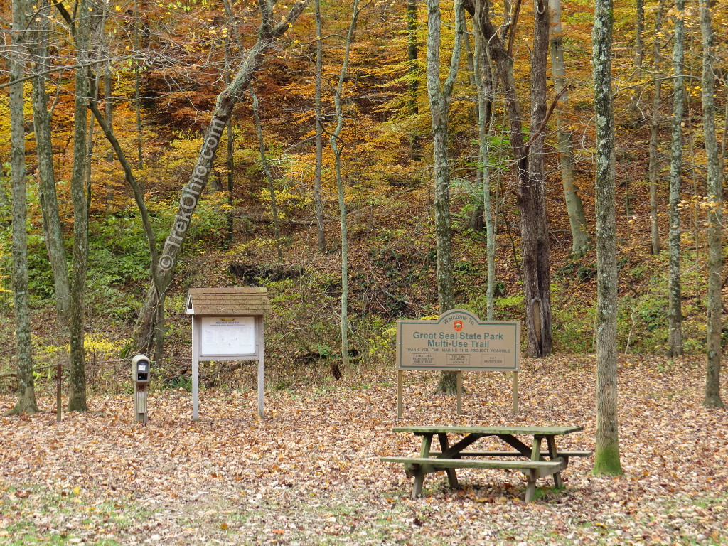 Great Seal State Park sign and picnic table in front of trees with autumn leaves