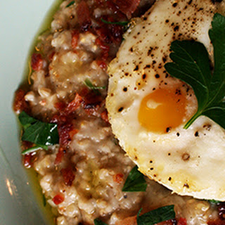 Savory Bacon Steel Cut Oats Topped with Baked Eggs