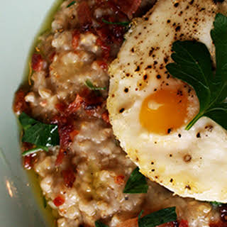 Savory Bacon Steel Cut Oats Topped with Baked Eggs.