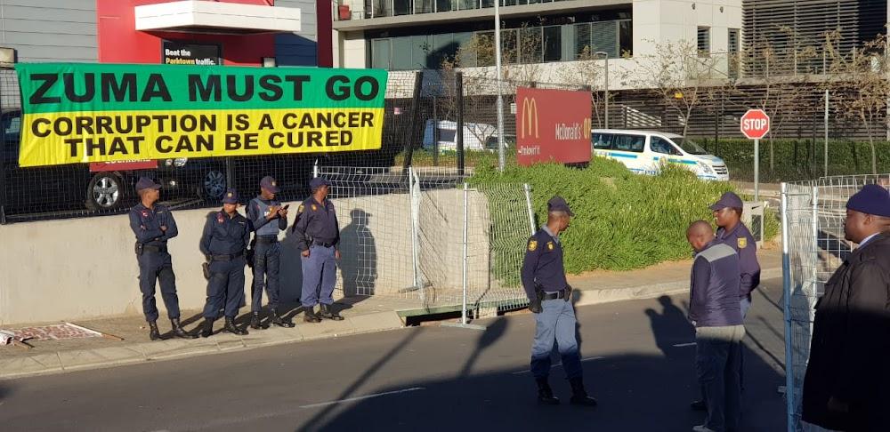 Rival protesters scuffle over anti-Zuma banner at state capture probe