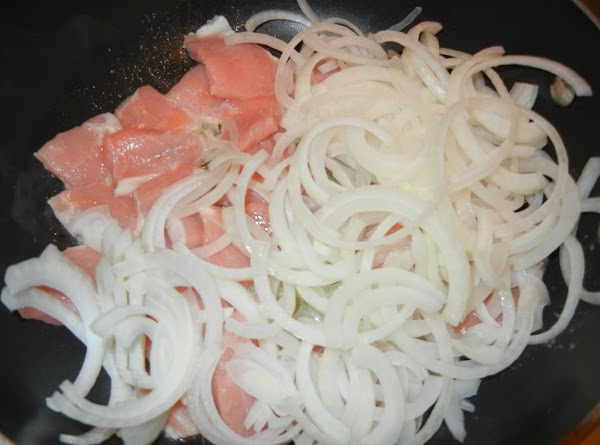 Add pork and veal cubes and onions.