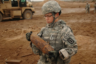 Photo: U.S. Army Spc. Robert Contreras attached to the 789th Explosive Ordinance Disposal Company (EOD), carries munitions to be destroyed during a controlled detonation operation at Forward Operating Base Delta, in southern Iraq, Oct. 31, 2009.  The 789th EOD conducts controlled detonations to destroy munitions seized in raids and those found in weapons caches.  (U.S. Army photo by Staff Sgt. Brien Vorhees/Released)