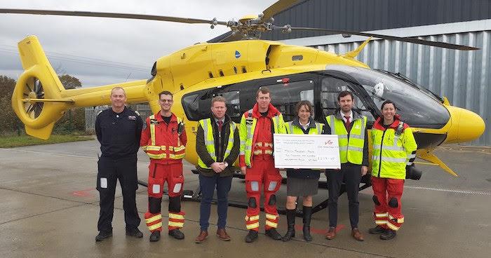 Estate agent's staff raise cash for Wales Air Ambulance