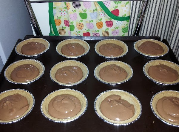 For Cheesecake filling: Blend cream cheese and sugar. Add chocolate syrup, vanilla, flour, egg and...