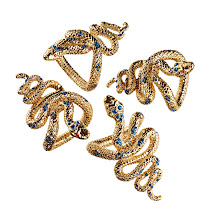 Photo: L'OBJET POUR FORTUNY Exclusively ours. Set of four 14k gold plated serpent napkin jewels. $150. Also available in platinum plated. Imported. Seventh Floor. 212 872 2686