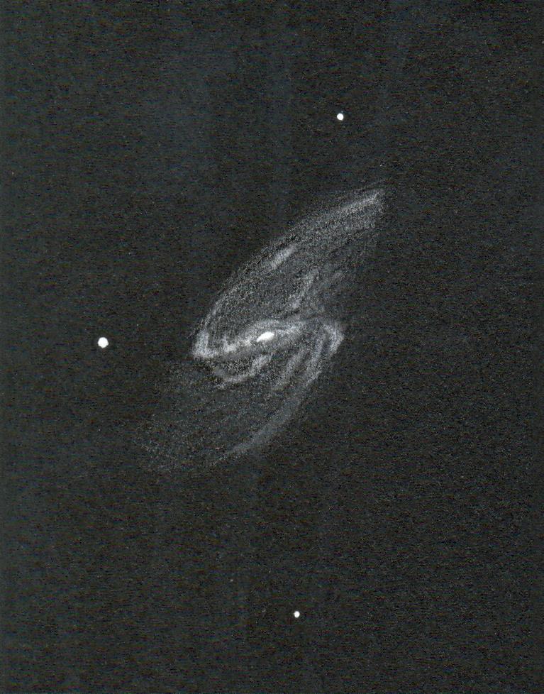 """Photo: M66, l'une des galaxies du """"trio"""" du Lion. Au T406 à 195X. Scan de mauvaise qualité."""