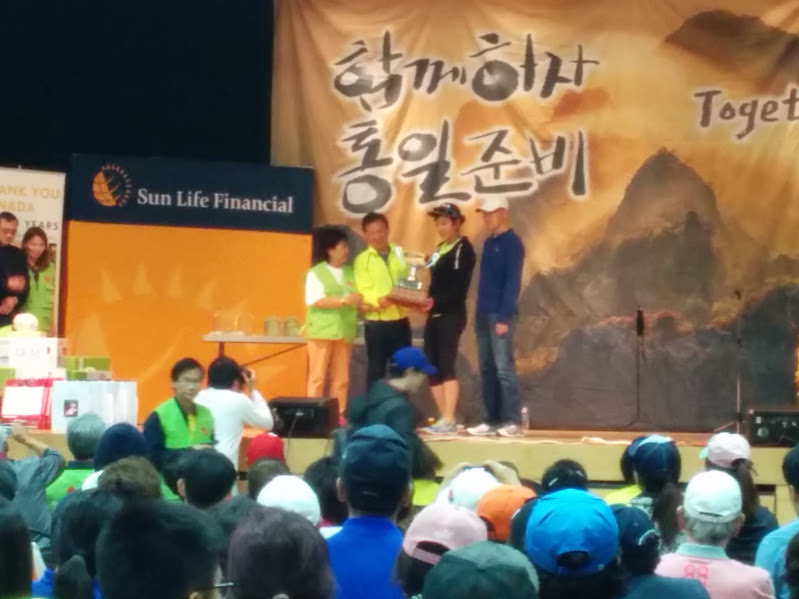 Toronto Runners Club receiving an award for the most participants at the Peace Marathon held by the KCCA
