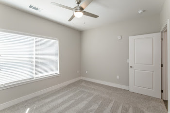 B7 bedroom with carpet and ceiling fan