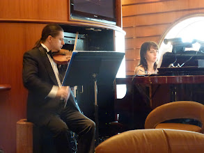 Photo: classical musicians work hard on the ship