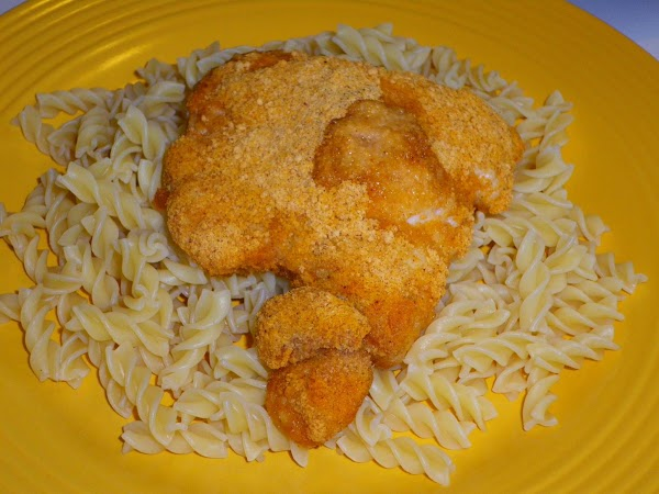 Place pasta on plate and top with chicken, sauce and shredded cheese.