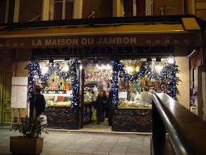 Photo: Last minute shoppers in late afternoon at a high end deli-type place – the French name sounds so much better than its translation: The House Of Ham.
