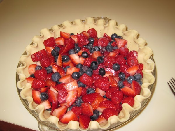 Place the ready made pie crust into pie place, flute the edges and polk...