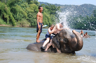 """Photo: Followed by the elephants """"spraying"""" the riders"""