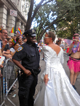 Photo: Flirting with a police officer.  The Heritage of Pride gay pride march, Christopher Street between Gay Street and Waverly Place, Greenwich Village, 26 June 2011. (Photograph by Elyaqim Mosheh Adam.)