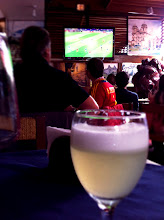 """Photo: Drinking a Pisco Sour to get into the """"spirit"""" of the Spain vs Italy 2012 Euro Cup Championship game while in Lima, Peru!  Peruvians are Spain fans and Spain WON 4-0!  Woohoo!  July 1, 2012."""
