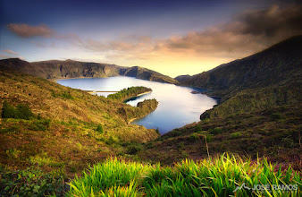 """Photo: """"The Fire Lake""""  Location: S. Miguel, Azores, Portugal  José Ramos © http://www.joseramos.com  An image I've taken some years ago, sitting on my hard drive , waiting for a much deserved re-process. Shot with older gear, before cameras had infinite dynamic range, when I had much less knowledge about ND grad filters. The previous published version didn't make the original scene full justice, so here is the new one.  This photo was taken in one of the islands of the magical and gorgeous Azores archipelago. I went to the S. Miguel island on a job assignment, and free time was scarce. Fortunately, me and a group of friends managed to arrange a 4 hour car travel through the island, and what a feast for the eyes that trip was! This is, in my opinion, along with S. Jorge, the most beautiful island in Azores. Breathtaking landscapes around every corner and, if it weren't for my passion for Iceland, I would return there very soon!  The depicted lake is located on the top of a volcanic mountain, and it's called Lagoa do Fogo (Fire Lake). It's the 2nd largest lake of the island, and it's located 575 metres high.  #azores  #portugal  #landscapephotography  #landscapephoto  #stunningmoment  #photomaniaportugal  #photomaniaglobal  #sunsetphotography"""