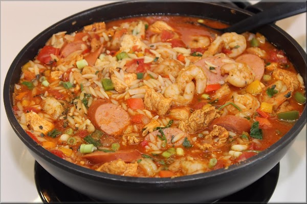 Step 3  Now add to the skillet, tomatoes and chicken broth and combine with shrimp....