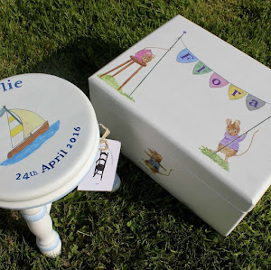 a child's keepsake box next to a child's milk stool
