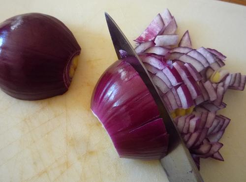 Chop red onion. Add to bowl.