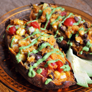 Southwestern Stuffed Sweet Potatoes with Avocado Sauce.