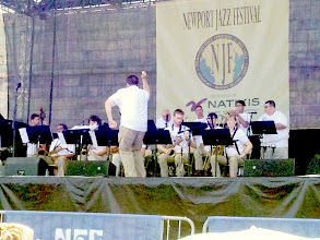 Photo: Jared Sims leading the URI Big Band. Conducting or doing the Funky Monkey