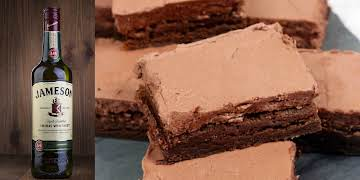 Irish Whiskey Brownies topped with Whiskey Fudge Frosting