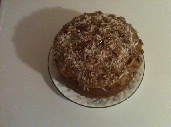 Sprinkled Coconut On Frosted Cake Since Most Photos Of Cake Are Very Similar.  My Husband Said He Has Never Seen One Like That!