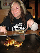 Photo: If you're thinking I look a little blitzed, well congratulations--you're right. This is our fifth restaurant and bar and I'm starting to feel the effects. Not that it stopped me from eating my share of this octopus and shrimp okonomiyaki.