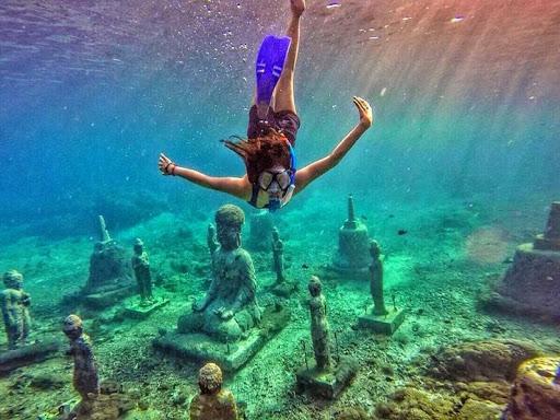 Snorkeling di patung buddha