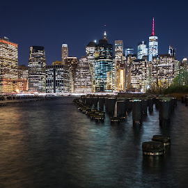Manhattan Skyline at Night by Carol Ward - City,  Street & Park  Skylines ( skyline, sticks, night skyline, manhattan, new york city, new york, nyc, night shoot, nightscape, brooklyn pavilion, brooklyn,  )