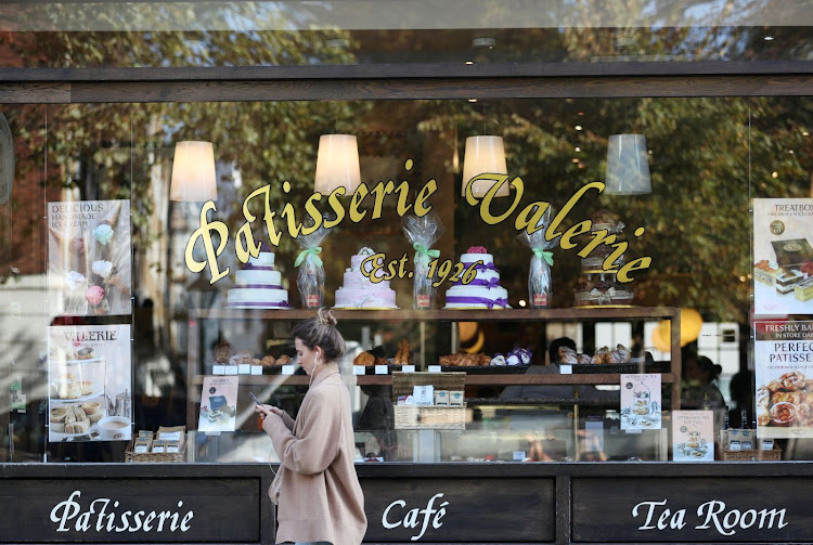 A woman walks past a branch of Patisserie Valerie in London, Britain. Picture: REUTERS/SIMON DAWSON