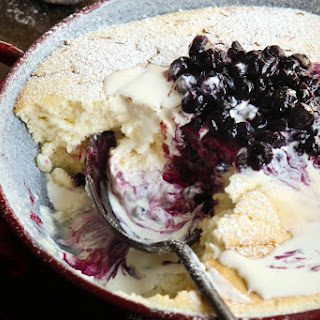 Lemon Pudding With Blueberry Compote.