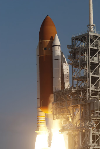 Space shuttle Discovery ignites for liftoff from Launch Pad 39A at NASA's Kennedy Space Center in Florida mission.