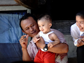 Photo: A father with his son, as well as motherat the wedding watching for the bride and groom to come forth.
