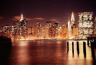 Photo: New York City Skyline. Night  In the blink of an eye the city's lights twinkle like stars in a universe that rises up from the ground to the surface of a darkening sky.  And all at once, everything else seems to fade away.  —-   This was taken on a frigid evening with the Sony A99 at Gantry Plaza State Park in Queens with wind gusts roaring across the river to the rocks I was teetering on with nothing more than my tripod and utterances of hope that the wind would let up for just a few seconds.  It didn't.  But as I stood there frozen in place for what seemed like the longest 30 seconds of the night, the city's glow rivaled that of a roaring fire and everything else seemed to pale in comparison.  ---  You can view this post with relevant links over at my photography blog here:  http://nythroughthelens.com/post/51263102675/new-york-city-skyline-night-midtown-in-the