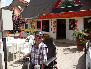 Photo: Local take away food or eat outside. Within 200m of wheelchair accessible holiday home. Pizza, Gyros, etc. Next door is the butcher.
