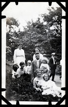 Photo: Tom Brandvold Album TBB153 / Laura Hansen back left.  Family in front is Alred Hansen with wife May and childen Winston (with long curls) and Evelyn.  Others not identified.